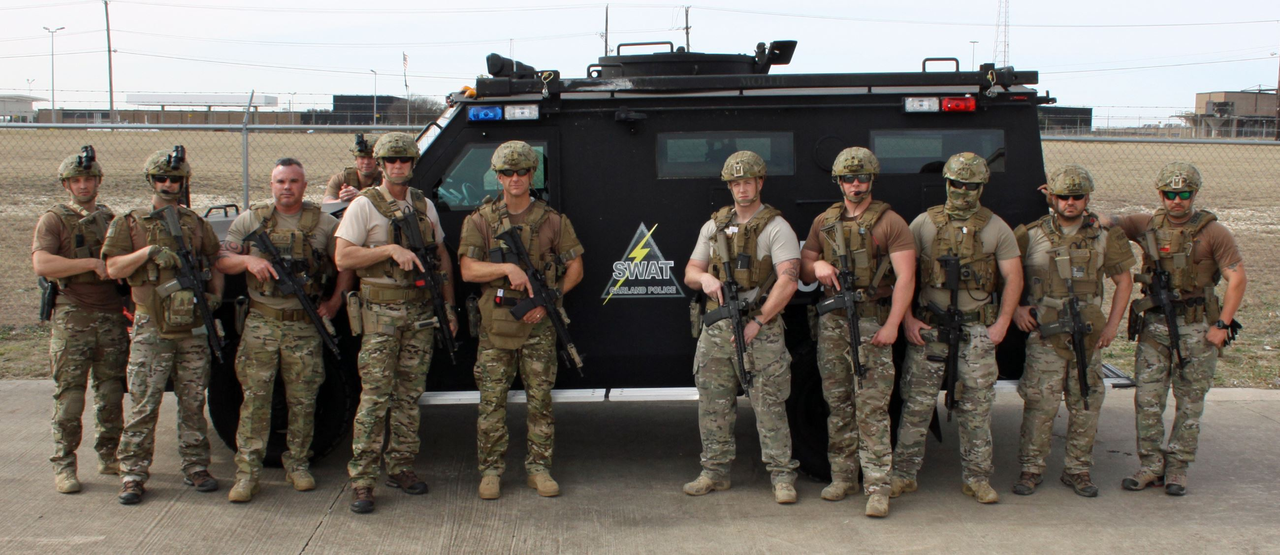 SWAT Team Group Picture in Front of a SWAT Vehicle
